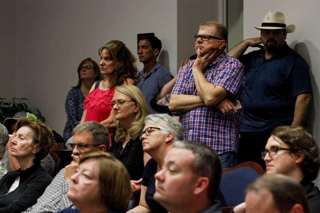 Residents of an Allen neighborhood fill the Allen City Council chambers to voice their opposition to a large retail-residential development during a public hearing in Allen, Texas, Tuesday, August 13, 2019. (Brian Elledge/The Dallas Morning News)