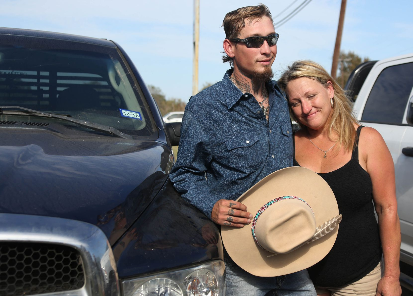 Johnnie Langendorff poses for a photo with his mother Heather Langendorff by the truck he used during a high speed pursuit of the Sutherland Springs Baptist Church gunman after the killing rampage at the church in Sutherlnd Springs, Texas.
