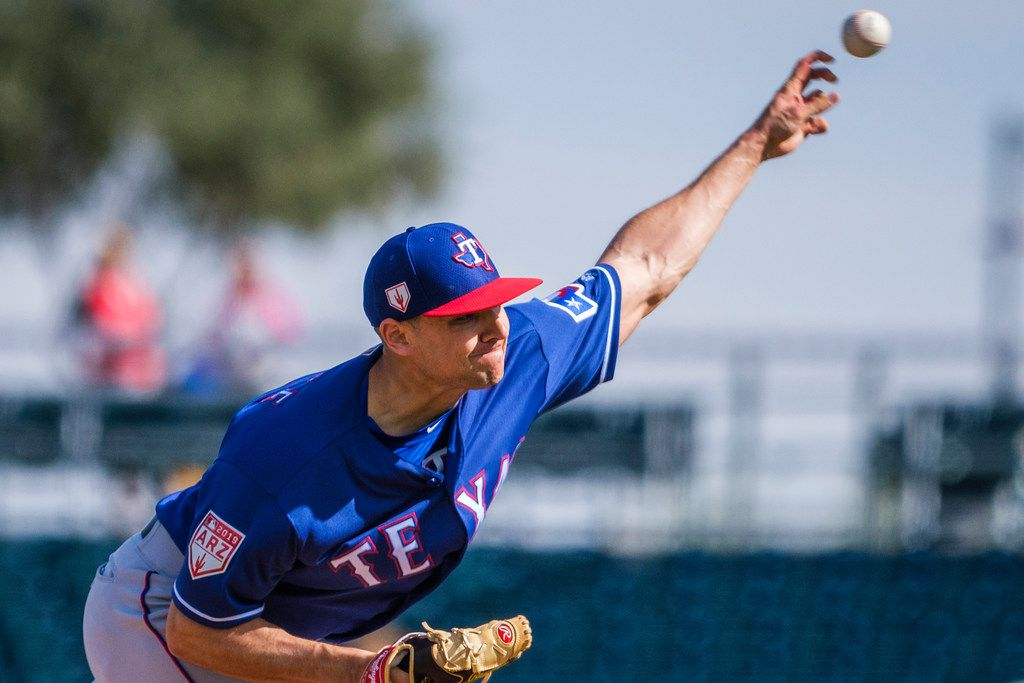 Texas Rangers pitcher Brock Burke pitches during the sixth inning of a spring training baseball game against the Cleveland Indians on Monday, Feb. 25, 2019, in Goodyear, Ariz.. (Smiley N. Pool/The Dallas Morning News)