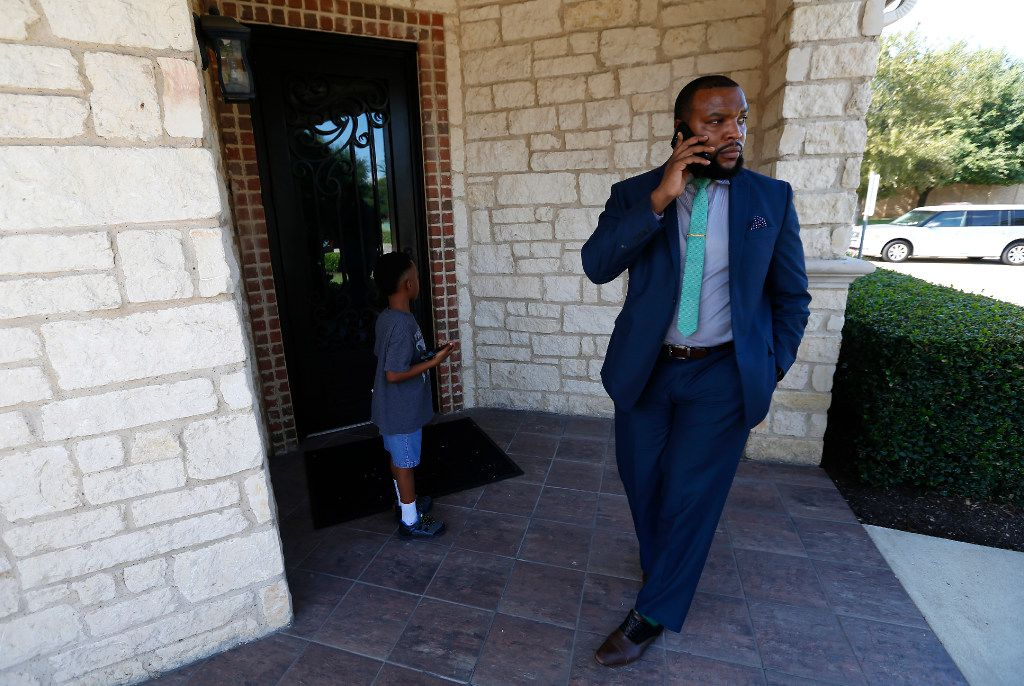 Attorney Lee Merritt (right) talks on his cell phone as he tries to find an entrance of the Orthodontic office where his 7-year-old son Stacy Merritt, Jr., has a retainer in Allen.