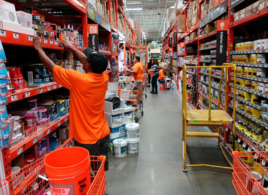 Workers stock the shelves at a Home Depot store in New Jersey.