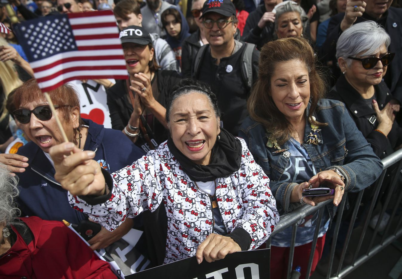 Rosa Guerrero (center) of El Paso sings along with the national anthem at a Beto O'Rourke presidential campaign kickoff rally in downtown El Paso on Saturday, March 30, 2019.