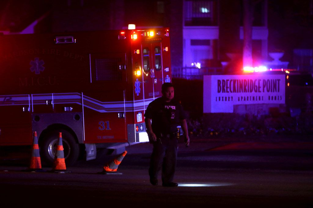 Police and fire personnel at the scene where an officer was fatally shot at Breckinridge Point apartment complex in Richardson, Texas on Wednesday, Feb. 7, 2018.