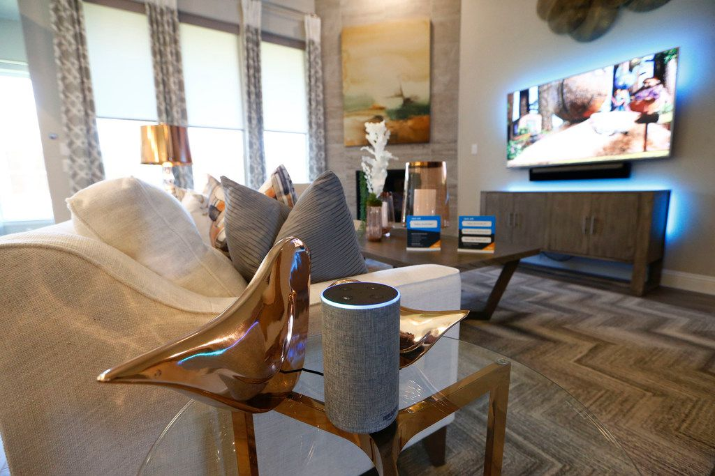 An Amazon Echo controls the blinds and television lighting at an Amazon Experience Centers model home.