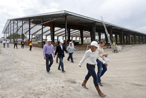 Council members and staff tour the Texas Horse Park, the city-funded center scheduled to open in October in southeastern Dallas.