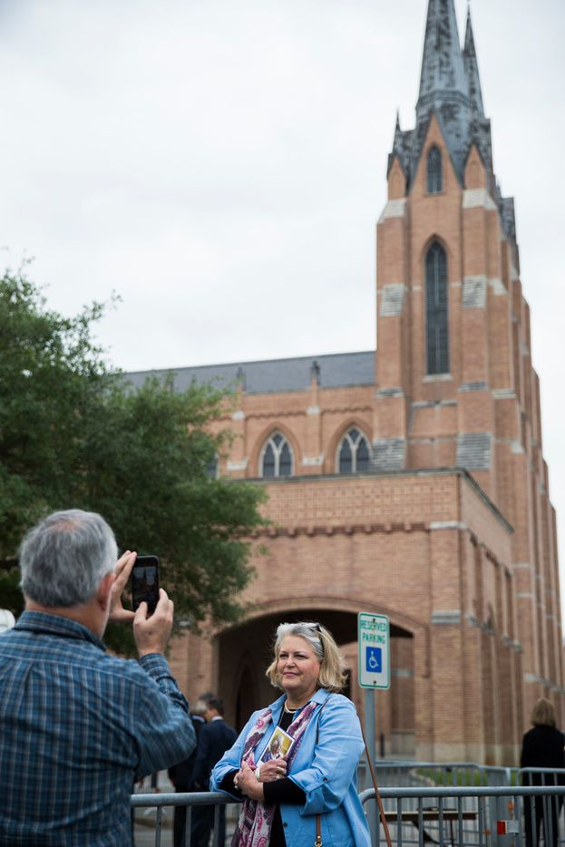 A woman has her photo taken as guests arrive to view the casket of former first lady Barbara Bush on Friday, April 20, 2018 at St. Martin's Episcopal Church in Houston. Bush died on Tuesday and her funeral services are on Saturday. (Ashley Landis/The Dallas Morning News)