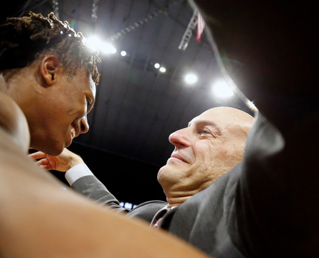 Head coach Duane Gregory hugs Mansfield Timberview's Trazarien White #23. UIL boys basketball 5A State Final between Mansfield Timberview v San Antonio Wagner on Saturday March 9, 2019 at the Alamodome in San Antonio, Texas. (Ron Cortes/ Special Contributor)