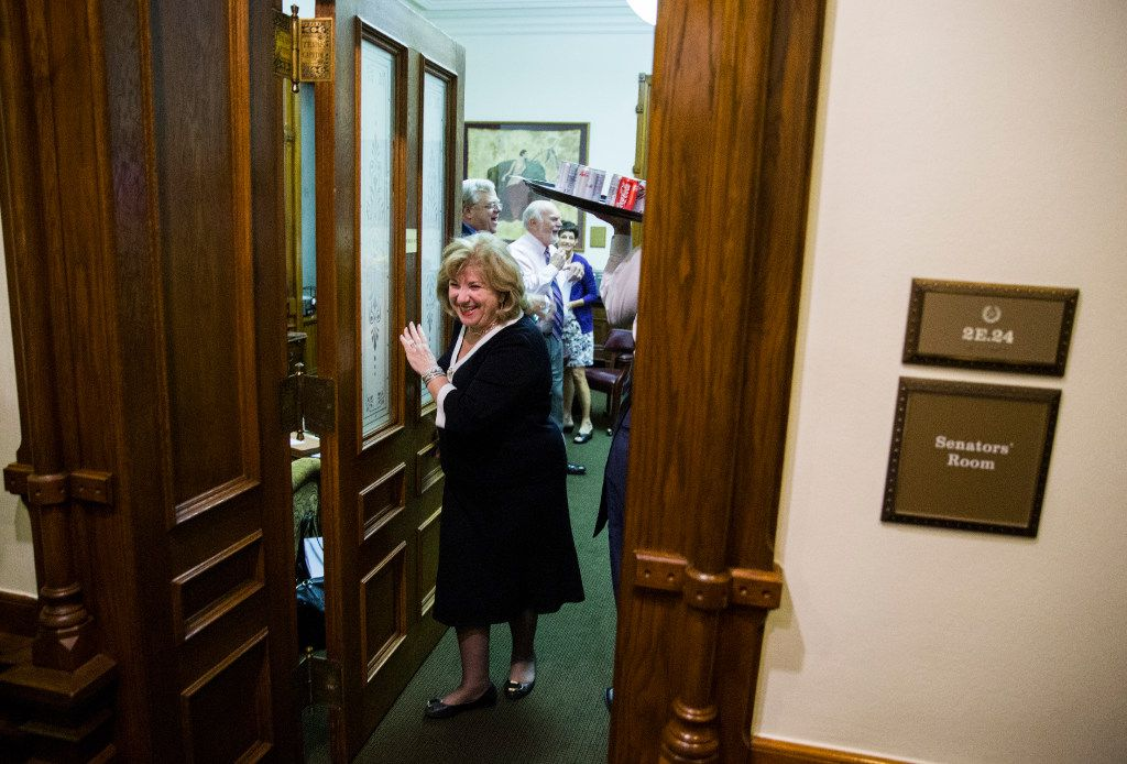 Sen. Jane Nelson laughs as she exits the Senators' Room where Lt. Gov. Dan Patrick serves soda and pizza before the Senate reconvenes at 12:01 a.m. for a third reading of the Sunset Bill during the third day of a special legislative session on Thursday at the Texas state capitol in Austin, Texas.