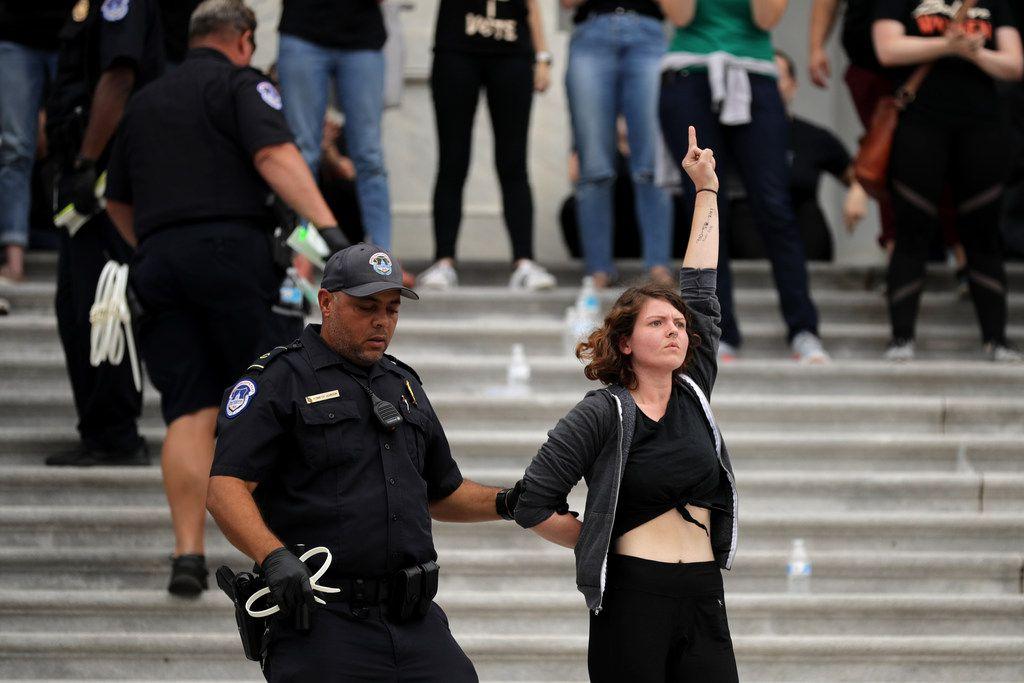 U.S. Capitol Police arrest hundreds of protesters after they occupied the center steps of the East Front of the U.S. Capitol to demonstrate against the confirmation of Supreme Court nominee Judge Brett Kavanaugh on Oct. 6, 2018 in Washington, D.C.