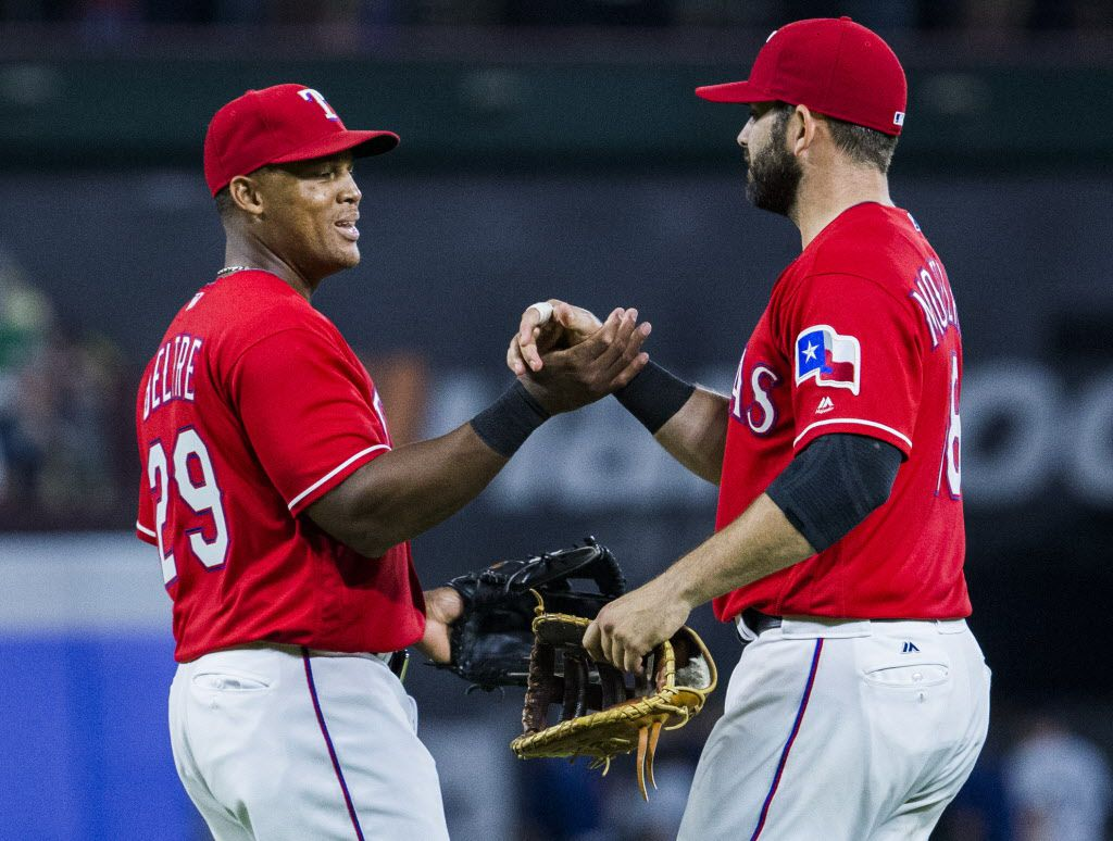 Texas Rangers third baseman Adrian Beltre (29) and first baseman Mitch Moreland celebrate after a 10-4 win over the Seattle Mariners on Saturday, June 4, 2016 at Globe Life Park in Arlington, Texas.  (Ashley Landis/The Dallas Morning News)