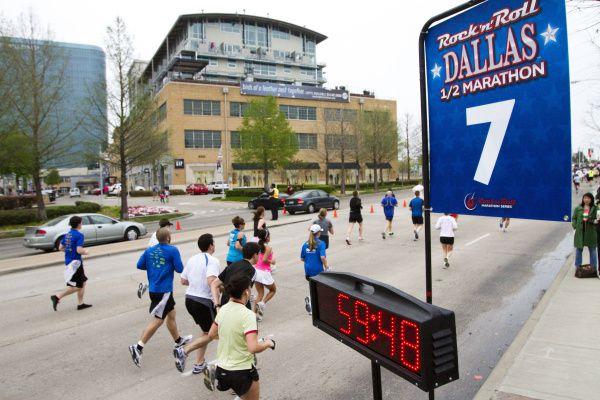 Runners in the Rock 'n' Roll Dallas half-marathon pass Mockingbird Station.