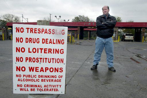 Dale Davenport,  photographed in front of his car wash in 2004, said he's done what he can to rid his property of crime. (Staff photo)