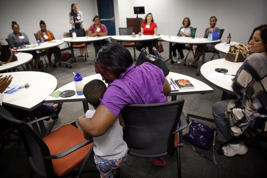 Antranette Canady hugs her 5-yr old grandson, Kwamane Dale during a Women's Independence Network (WIN) support group meeting for former incarcerated women.  The meetings were started by Unlocking DOORS, a Dallas-based nonprofit working to reduce recidivism. The group met for a third time at the Bill J. Priest Institute for Economic Development in S. Dallas, Wednesday, April 22, 2015. DOORS founder, president and CEO Christina Melton Crain said this is one of the only support groups specifically for women after they are released from prison. The Dallas Women's Foundation provided funding for the support group.