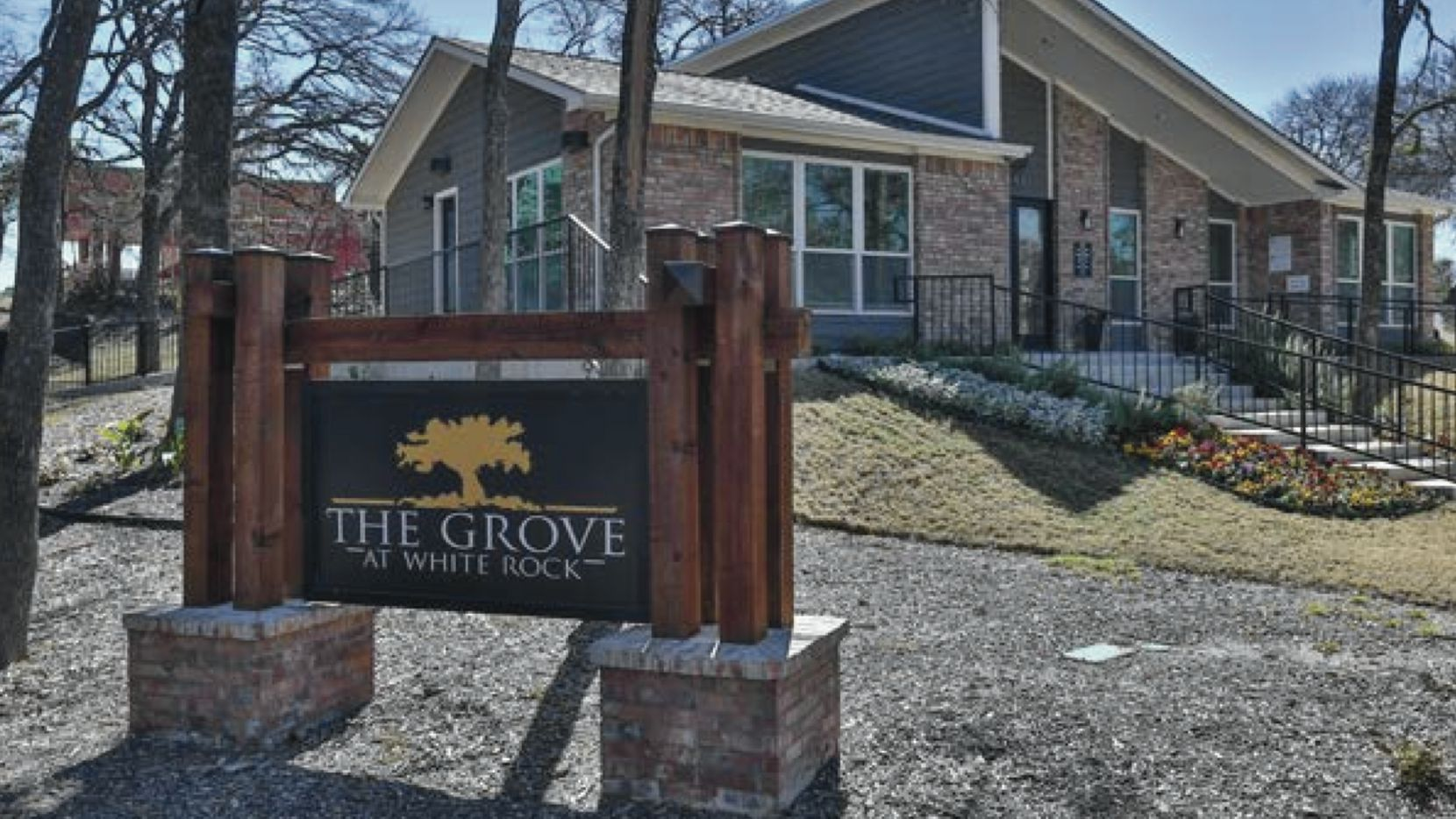 """New owners of The Grove apartments near White Rock Lake are renaming the community """"The Zeke."""""""
