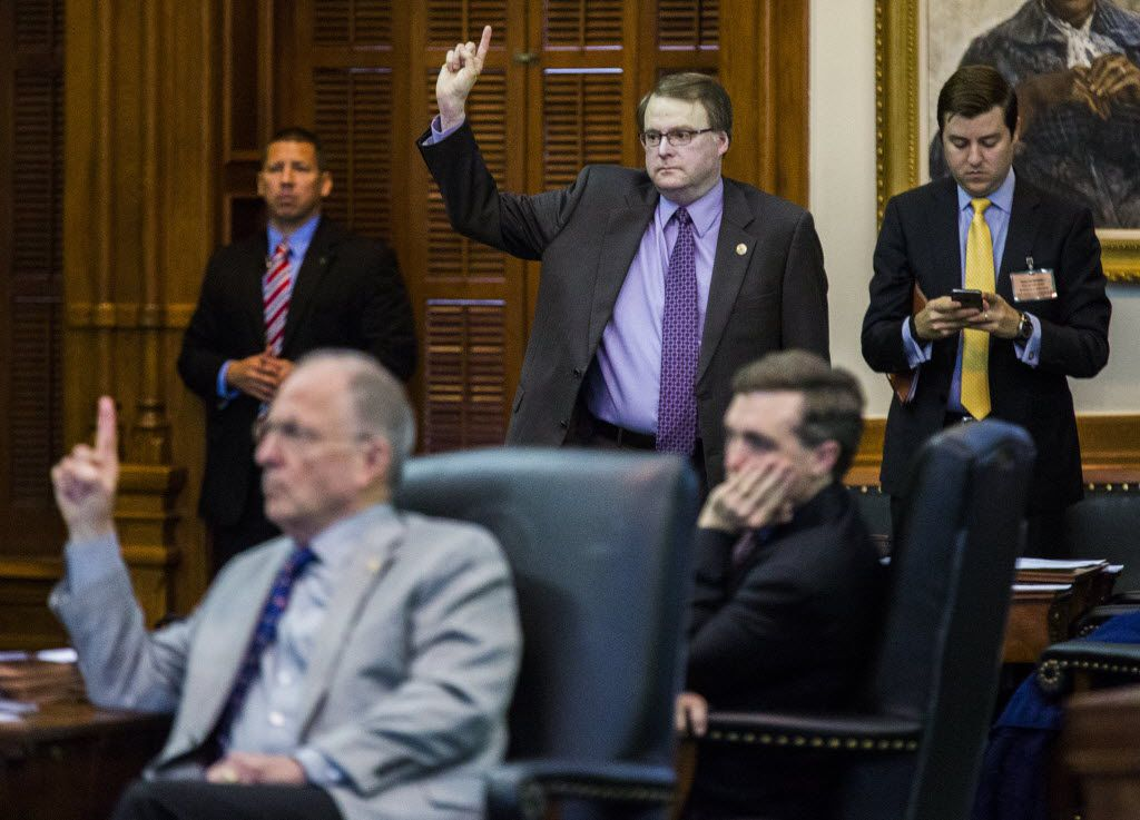 Sen. Bob Hall, R-Edgewood, left, and Sen. Brian Birdwell, R-Granbury, voted for SB 11, legislation relating to allowing concealed handguns on college campuses, during the final days of the 84th Texas legislature regular session in 2015.
