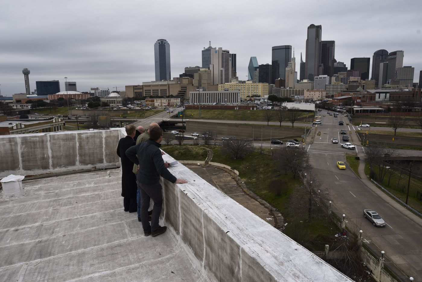Jim Lake Adaptive Urban Development representatives stood on the roof of the Ambassador Hotel during a tour on Jan. 30, 2019.