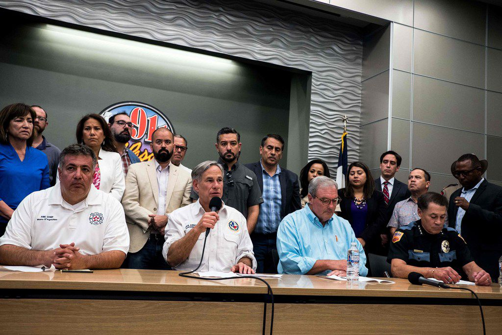 El Paso Police Chief Greg Allen (far right) appeared with (from left) Fire Chief Mario D' Agostino, Gov. Greg Abbott and Mayor Dee Margo hours after the mass shooting at a Walmart in the city. (Joel Angel Juarez/AFP/Getty Images