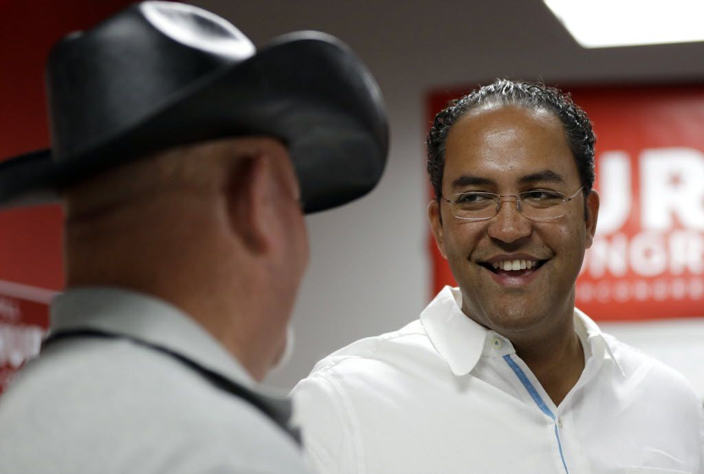 First-term  Rep. Will Hurd, R-San Antonio,  (right) talks with a supporter at a campaign office. Many House Republican incumbents worry that blowback from Republican presidential nominee Donald Trump's anti-Hispanic rhetoric and promises to build a towering wall the length of the U.S.-Mexico border could hurt their re-election chances. The problem is especially acute for those in heavily Latino districts like that of Hurd, whose territory encompasses 820 miles of the U.S.-Mexico border. (AP Photo/Eric Gay)