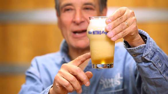 Boston Beer Co. founder Kim Koch demonstrates what happens when a canned nitro beer is poured into a glass.