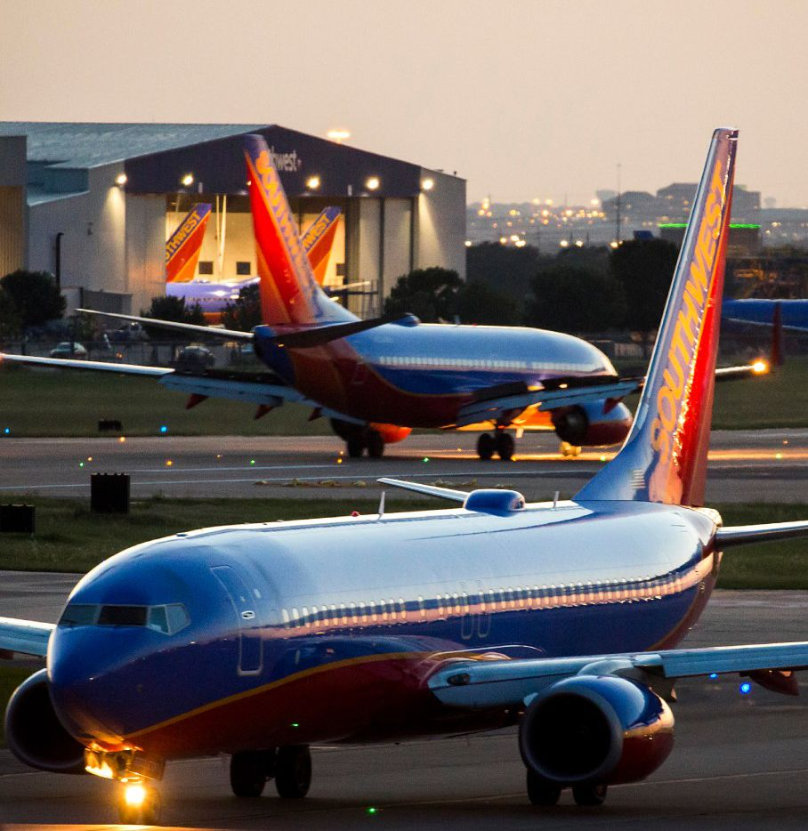 Southwest Airlines 737 planes taxi in opposite directions near a maintenance hangar at Love Field on Tuesday, June 6, 2017, in Dallas. (Smiley N. Pool/The Dallas Morning News)