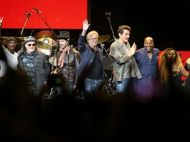 Eric Clapton (center) and friends acknowledge the crowd's applause after a finale, during the Crossroads Guitar Festival on Saturday, Sept. 22, 2019 at the American Airlines Center in downtown Dallas. He is flanked by Doyle Bramhall II, of Dallas, (on Clapton's right), and John Mayer. The concert put together by Eric Clapton, which benefits his Crossroads addiction recovery center, took place over two nights with different performers each night.