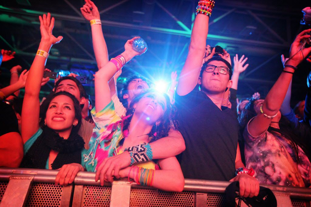 Emily Baird and Michael Skolnik of Hot Springs, Arkansas (center) cheer during Dada Life's set on the first evening of the Lights All Night dance festival at the Dallas Convention Center December 30, 2011. (Taylor Glascock/The Dallas Morning News) 10042012xBIZ 12282012xGUIDE 12272013xGUIDE