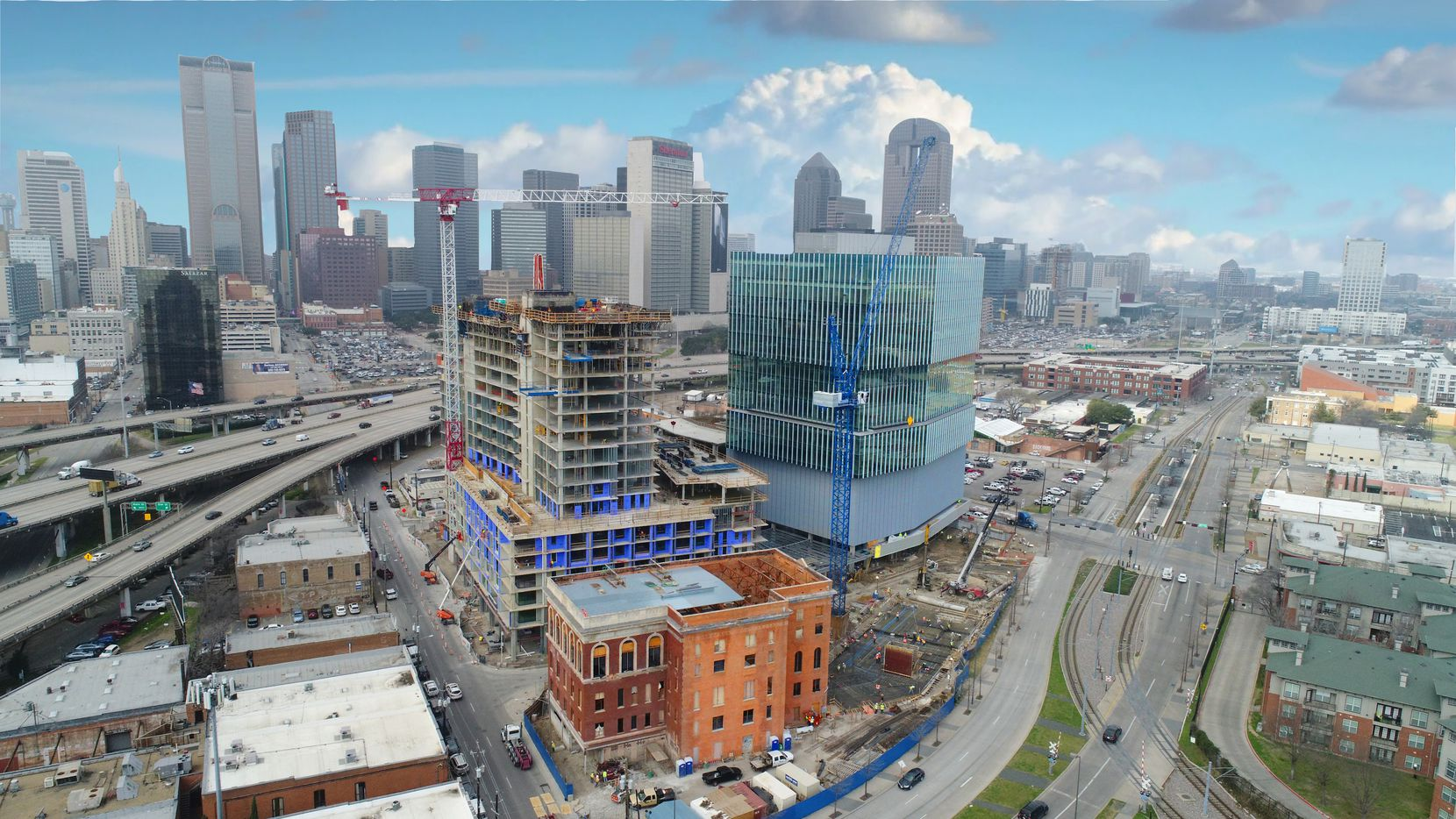 The Epic development on the eastern edge of downtown Dallas includes a new office tower, apartment high-rise and a luxury hotel in a restored landmark building.