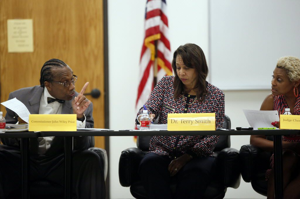 Dallas County Commissioner John Wiley Price speaks with Juvenile Department Director Terry Smith and Judge Cheryl Lee Shannon during a Dallas County Juvenile Board meeting in 2014.