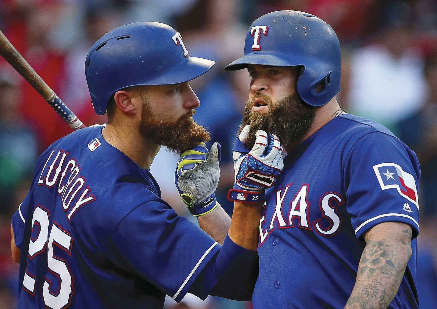 Rangers Mike Napoli (right) and teammate Jonathan Lucroy pull each other's beards after Napoli's third-inning home run against the Miami Marlins in Arlington.