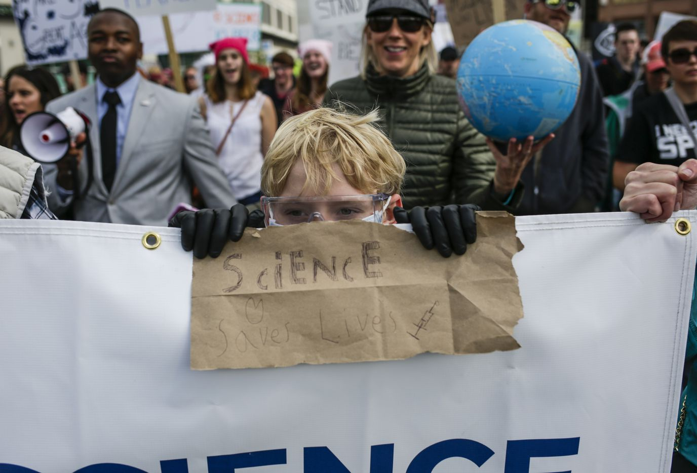 Dylan Sawyer, 12, of Boulder, Colo., during the March for Science in Denver, April 22, 2017. Thousands of scientists and science advocates demonstrated in Washington and in smaller events around the world to support, defend and celebrate the scientific enterprise. (Nick Cote/The New York Times)