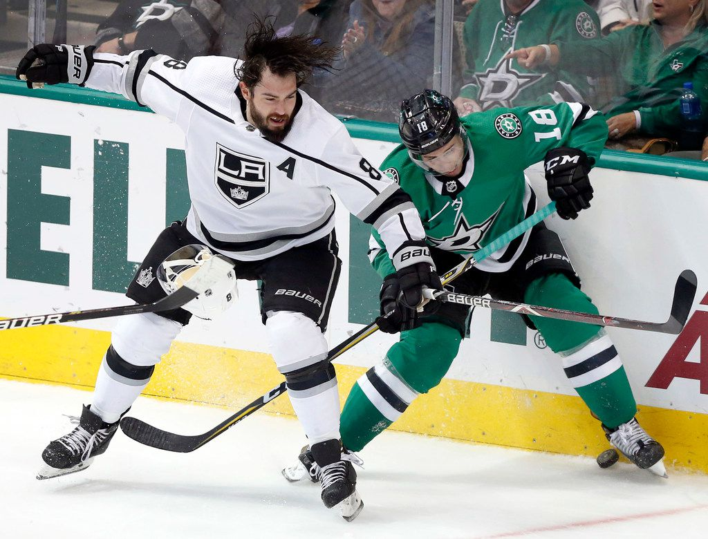 Los Angeles Kings defenseman Drew Doughty (8) looses his helmet as he's hit by Dallas Stars center Tyler Pitlick (18) during the second period at the American Airlines Center in Dallas, Tuesday, October 23, 2018. (Tom Fox/The Dallas Morning News)