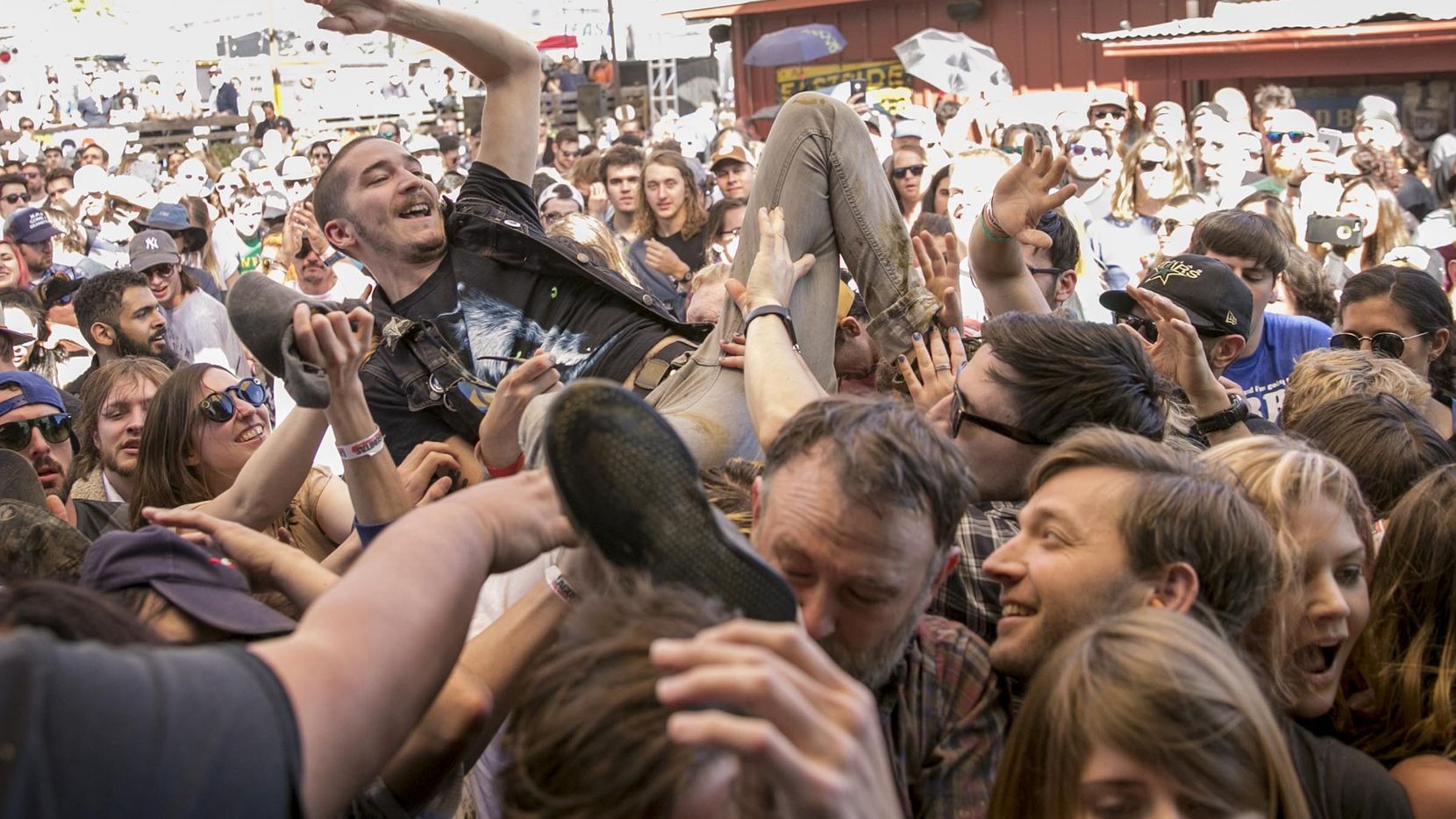 Brett Mason of Austin crowdsurfs during a set by Thee Oh Sees on Tuesday, March 14, 2017 at the Independence and Lagunitas Bug Out party at the Scoot Inn during South by Southwest. (Jay Janner/Austin American-Statesman/TNS)