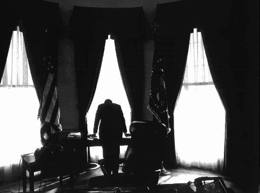 This silhouette of President Kennedy leaning on his desk  was one of the best known photographs by retired New York Times photographer George Tames. Tames, 75, a native of Washington,  died while undergoing heart surgery Feb. 23, 1994. He  photographed 11 presidents.