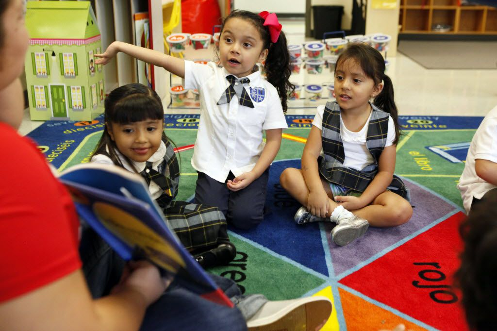"""Pre-k students (L-R) Vida Sanchez, Leah Pina, and Isabella Jaramillo, all three-years of age, participate in class as their teacher reads a Spanish childrens book titled """"Un Beso en Mi Mano,"""" during a class activity at Leonides Gonzalez Cigarroa MD Elementary School, on Friday, Aug. 28, 2015 in Dallas. DISD has a new program allowing children to begin pre-k at three years of age. Ben Torres/Special Contributor 08292015xPUB"""