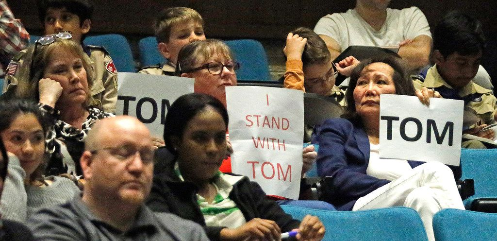 Supporters of councilman Tom Harrison hold signs in the audience as the Plano City Council considered a recall election for council member Tom Harrison during their open meeting on Monday, April 9, 2018.  (Stewart F. House/Special Contributor)