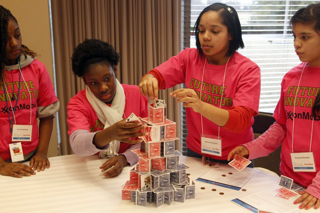 Aminia Randolph, Cecelia Kalu, Leilana Azalia Davis, and Kimberly Resendez, try to make the highest weight-supporting tower with playing cards during the 10th annual Introduce a Girl to Engineering Day at the Exxon-Mobil headquarters in Irving, on February 20, 2013.
