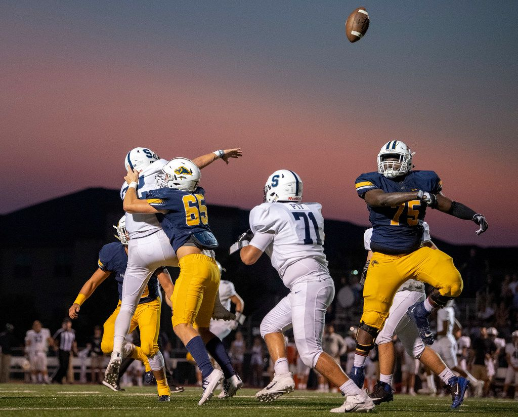 Plano Prestonwood Christian defensive linemen and Fort Worth All Saints offensive lineman compete for the ball after it was batted by Plano Prestonwood Christian senior offensive lineman Javan Bouton (75) in the first half of a high school football game on Friday, October 4, 2019 at Lions Stadium Plano, Texas. (Jeffrey McWhorter/Special Contributor)