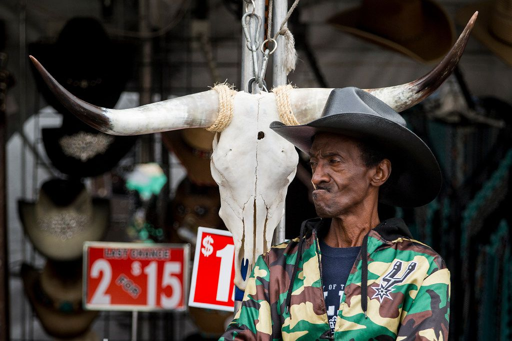 Willie Green wait for customers to stop by a hat stall where he works during the State Fair of Texas at Fair Park on Friday, Oct. 14, 2016, in Dallas. (Smiley N. Pool/The Dallas Morning News)