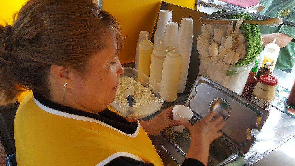 Susana Soto prepares the corn for an elote at Elotes Fanny on Harry Hines Boulevard in Dallas.