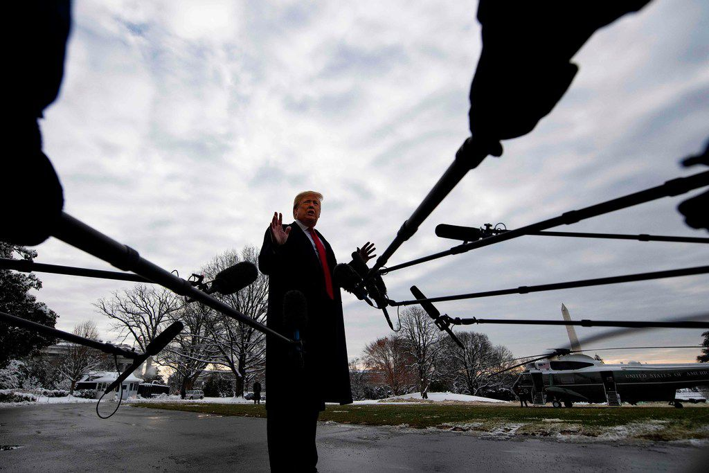"U.S. President Donald Trump speaks to the media as he departs the White House in Washington, D.C., on Jan. 14, 2019 en route to New Orleans  to address the annual American Farm Bureau Federation convention. On Monday, Trump said he has ""never worked for Russia,"" assailing reports that raised questions about his ties to Vladimir Putin as a ""big fat hoax."" Trump's comments to reporters at the White House followed a Washington Post report over the weekend that said the president has kept his top aides in the dark about his private conversations with the Russian leader."