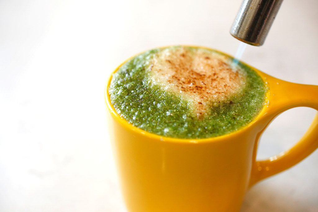 The Matcha Creme Brulee latte is torched at La La Land Kind Cafe in Dallas on Monday, April 22, 2019. (Rose Baca/Staff Photographer)
