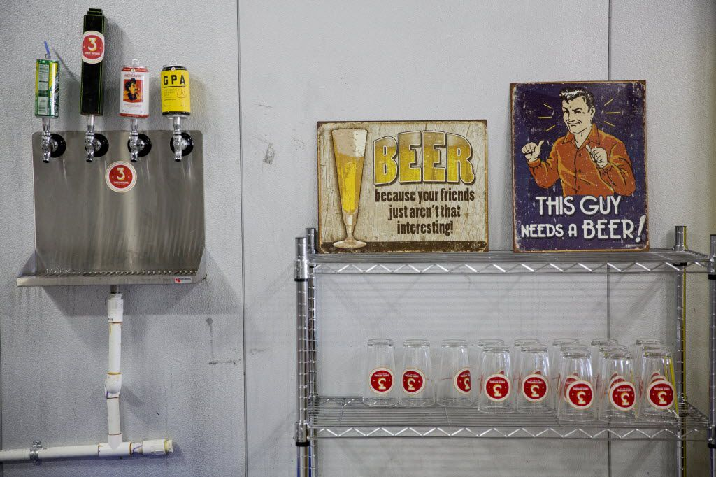 A wall houses glasses and taps used for sampling beers at 3 Nations Brewing Friday, October 16, 2015 in Farmers Branch, Texas. The brewery has been in operation for about four months, and currently produces three different kinds of beer.