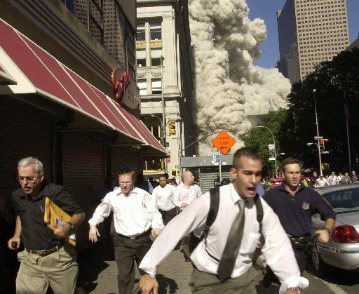 People run from the collapse of World Trade Center Tower  Tuesday, Sept. 11, 2001 in New York.