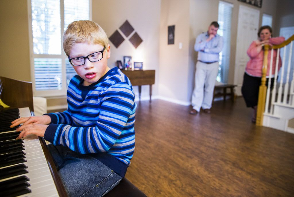 "Ben Schneider, 11, plays Ben Folds' ""Sky High"" on piano in his home while his parents, Rob and Jenn Schneider watch on Tuesday, April 12, 2016 in Frisco. Schneider is autistic, has impaired vision and has cerebral palsy.  He will have the chance to meet his favorite musician, Ben Folds, on Thursday when he performs at The Majestic. (Ashley Landis/The Dallas Morning News)"