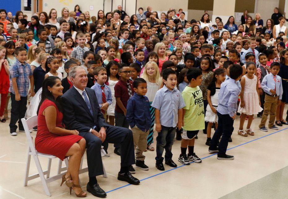 Former President George W. Bush sits next to principal Maricela Helm during the dedication of George W. Bush Elementary. (David Woo/Staff Photographer)