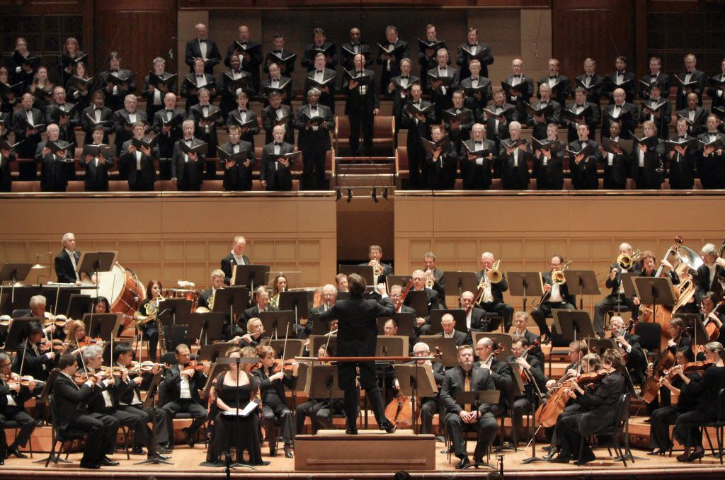 The Dallas Symphony Orchestra with conductor Tomas Netopil, center, solo soprano Twyla Robinson, left,  solo baritone Weston Hurt, right, and the Dallas Symphony Chorus, on Oct. 31, 2013 at the Meyerson Symphony Center in Downtown Dallas.