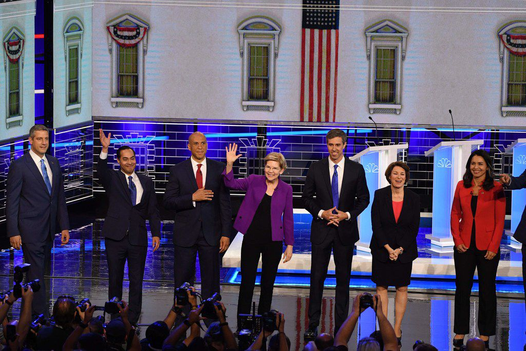 From left: Rep. Tim Ryan, former Housing Secretary Julian Castro, Sen. Cory Booker, Sen. Elizabeth Warren, former US Rep. Beto O'Rourke, Sen. Amy Klobuchar and Rep. Tulsi Gabbard participates in the NBC News Democratic  debate at the Adrienne Arsht Center for the Performing Arts in Miami.
