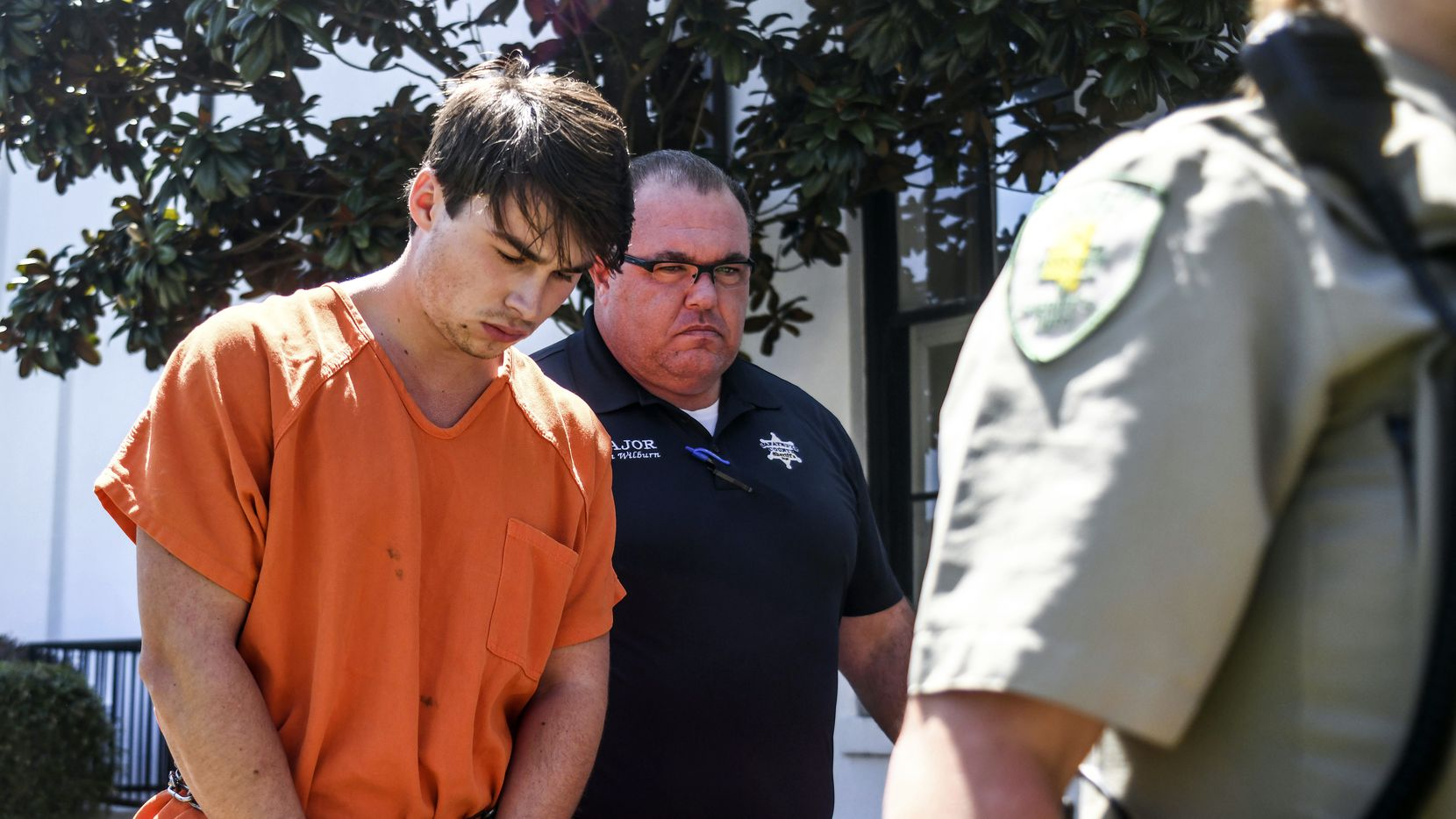 """Brandon Theesfeld is led from the Lafayette County Courthouse in Oxford, Miss., Tuesday after being arraigned in connection with the death of 21-year-old University of Mississippi student Alexandria """"Ally"""" Kostial."""