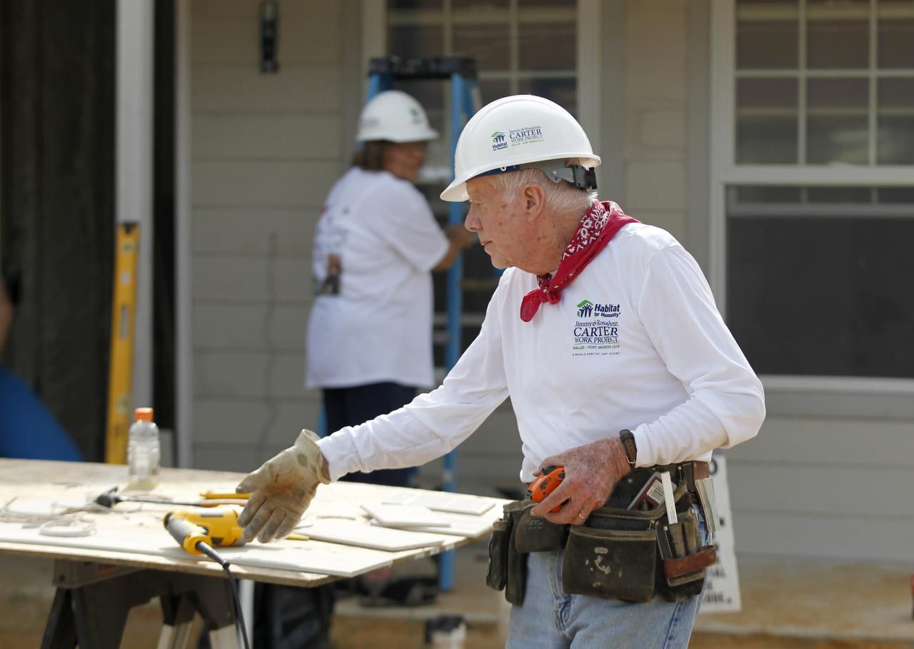 Former President Jimmy Carter pitched in to help on a house for Habitat for Humanity, near the VA Hospital in southern Dallas last November.