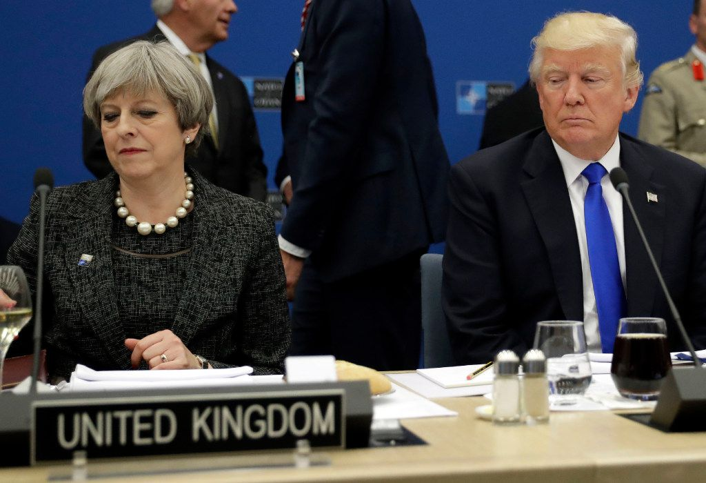President Trump sits next to British Prime Minister Theresa May during a NATO summit in Brussels on May 25, 2017.